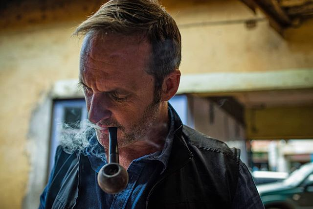 Wayne Hennessy-Barrett, 46, smokes his pipe at his 4G Capital officein Wangige Town, Kenya. The ex Major served in Afghanistan, Bosnia, Kosovo and Iraq before founding 4G Capital, a company that offers credit lines to small businesses in Kenya, in 2013. Despite no finance experience, Hennessy-Barrett has more than 300 employees in 70 outlets across Kenya. He often references military concepts and tactics to grow his business. On assignment for @telegraph . . . . . . . . . #nikond810 #development #news #kenya #photojournalism #militarylife #documentaryfilmmaking #instadaily #everydayeverywhere #everydayafrica #liveforthestory #photojournalism #magnumphotos #militarymen #people_infinity #military #thisweekoninstagram #OnAssignment #HartCollective #MyFeatureShoot #BalkanCollective #ReportageSpotlight #YourShotPhotographer #DocumentaryPhotography #FriendsInPerson @burnmagazine @theindependentphoto #gettyreportage #lensculturediscovery #womenstreetphotographers #independentphotography #spicollective