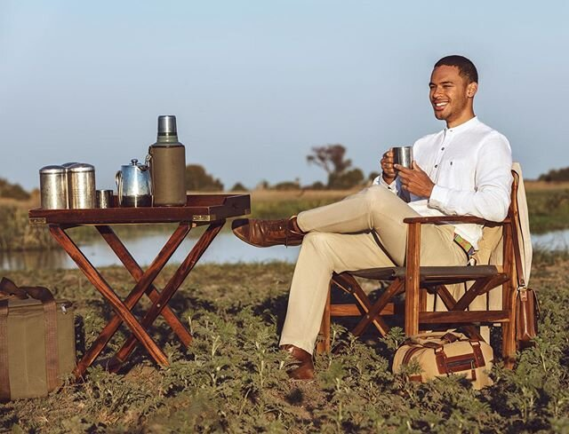Who else wants to wake up with coffee in hand whilst gazing out over the Okavango Delta? 🌴🌞🐾 | #dbexplorercollection . . . #safari #africansafari #safarioutfitinspo #bespoke #bespokesafariwear #okavangodelta #africa #safarivacation #safarioutfitter #menswear
