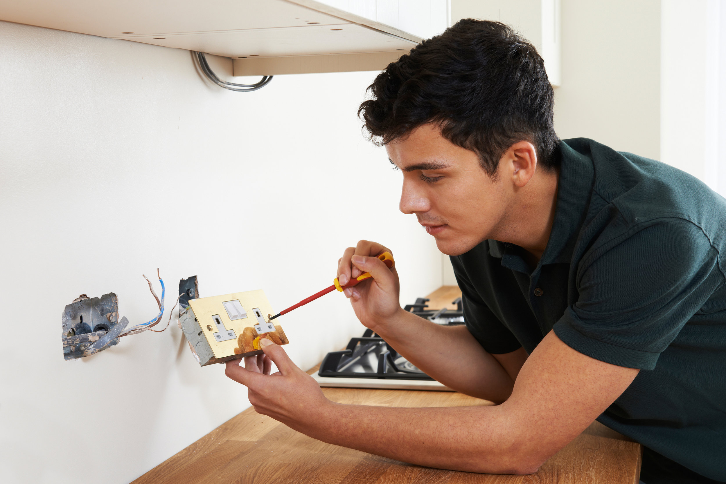 Electrician Installing Socket In New House.jpg
