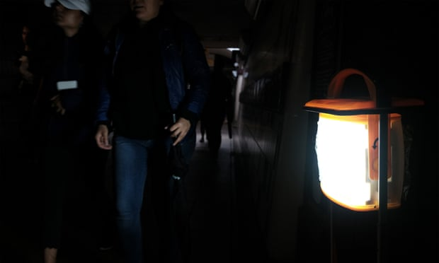 Temporary lighting is set up during the power cut affecting Clapham Junction train station. Photograph: Yui Mok/PA