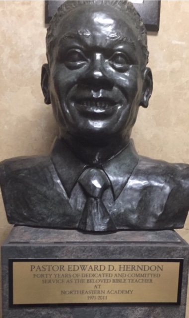 Bust dedicated to the memory of Pastor Edward D. Herndon which stands at Northeastern Academy.