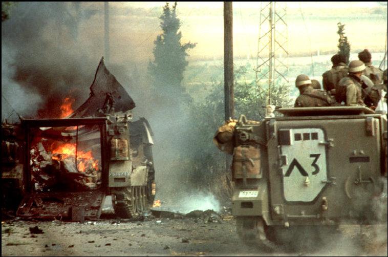 © Micha Bar Am/Magnum Photos: A column of Israeli armored personnel carriers runs into a PLO ambush east of Sidon, Lebanon (1982)