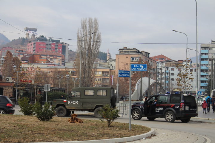 © Matthew Williams/The Conflict Archives: KFOR (the NATO-led international peacekeeping force) military jeeps and police guard Ibar bridge, the key link between northern and southern Mitrovica.