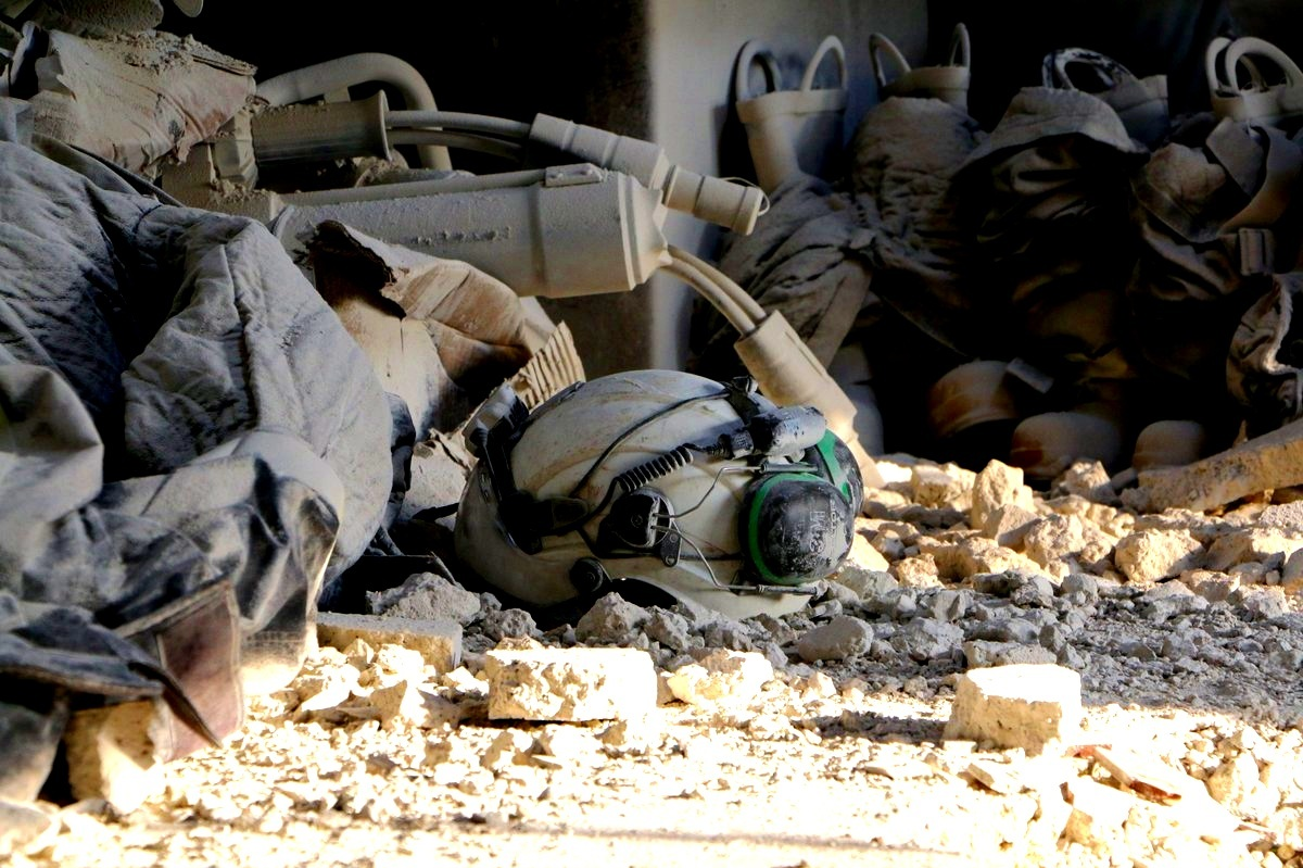 A helmet belonging to the Syria Civil Defence or White Helmets lies in the rubble. Image via   @SyriaCivilDef