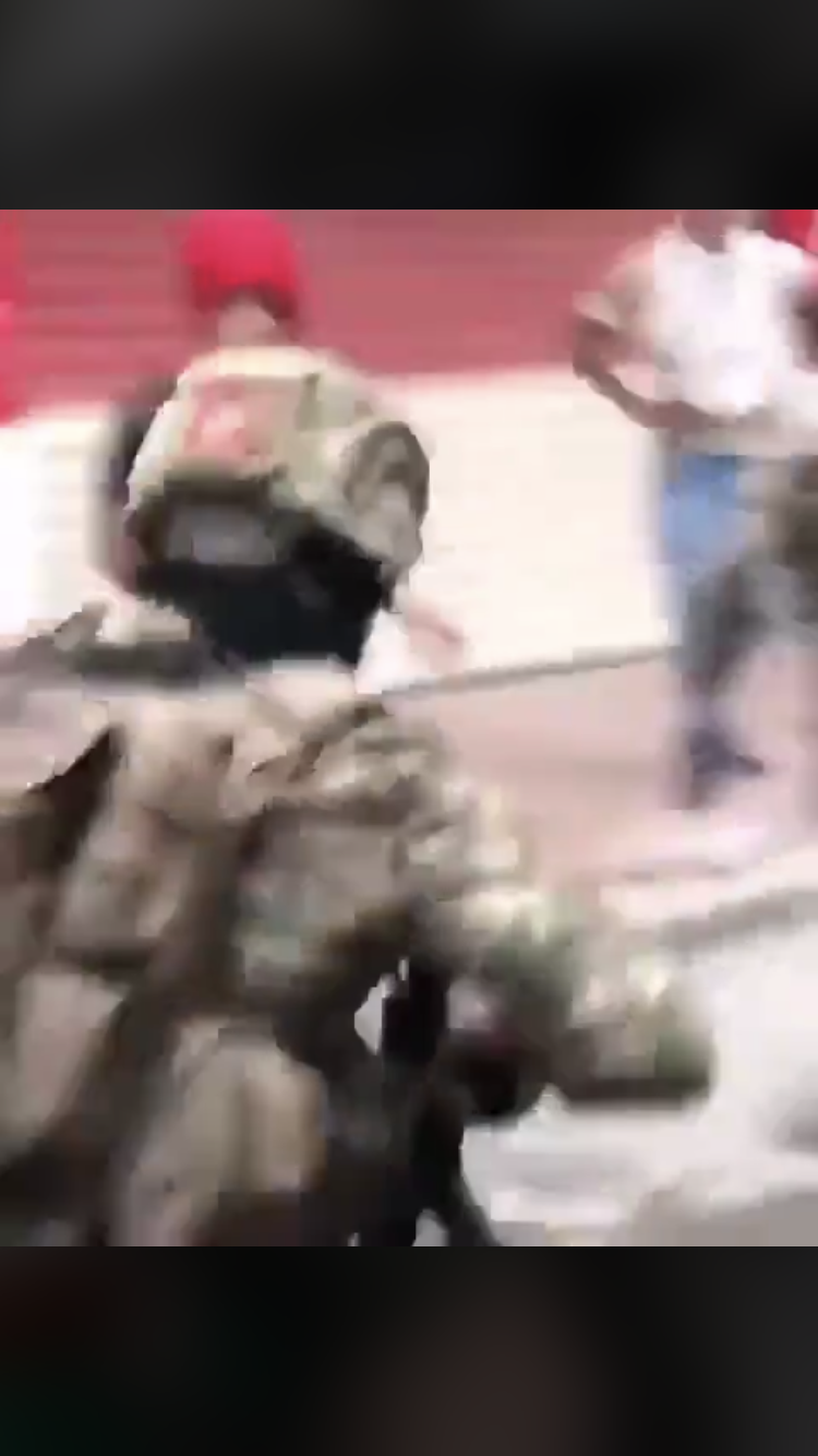 A still image from Twitter video posted by @BaghdadPostPlus showing Iraqi Security Forces/ERD police cracking down on protesters in Baghdad.