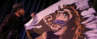 Artist Ricardo Barazza performing at Silver Dollar City's Paint Jam.