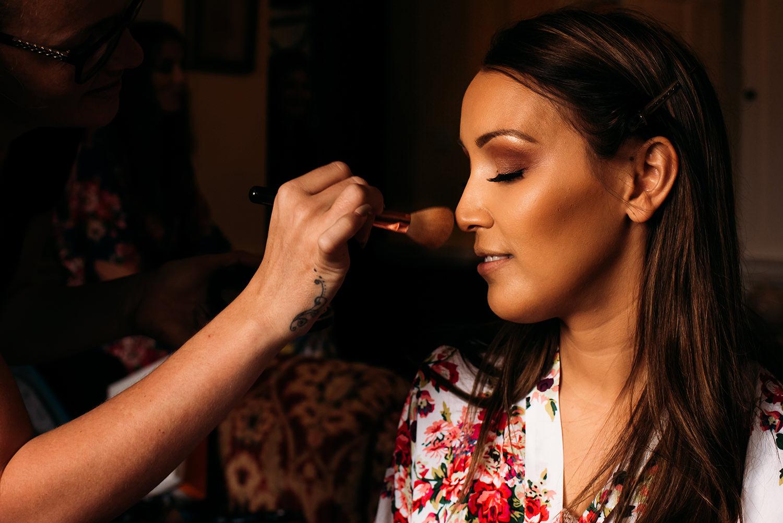 colour photo, make-up brush on brides nose