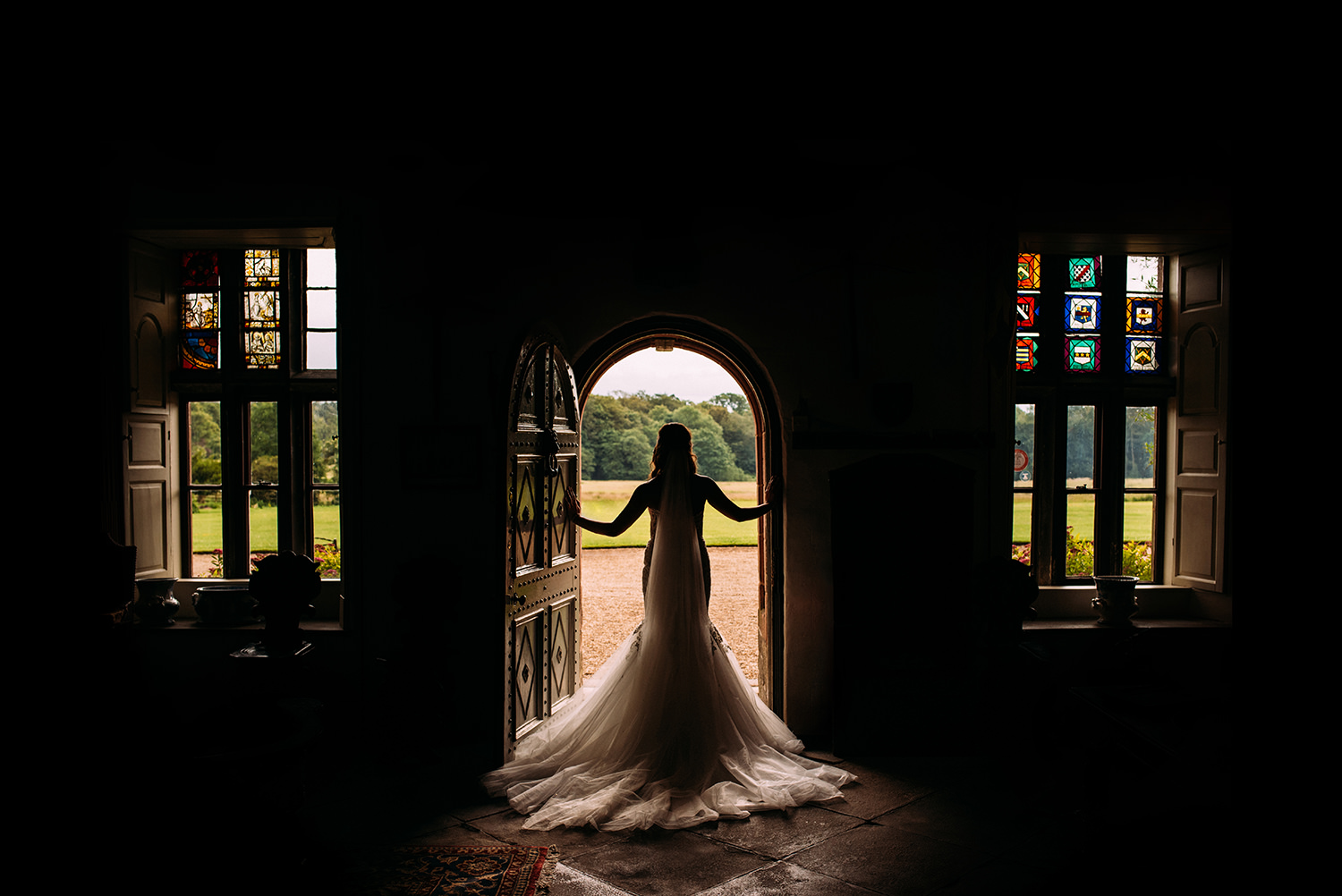colour photo, bride in doorway ready to go
