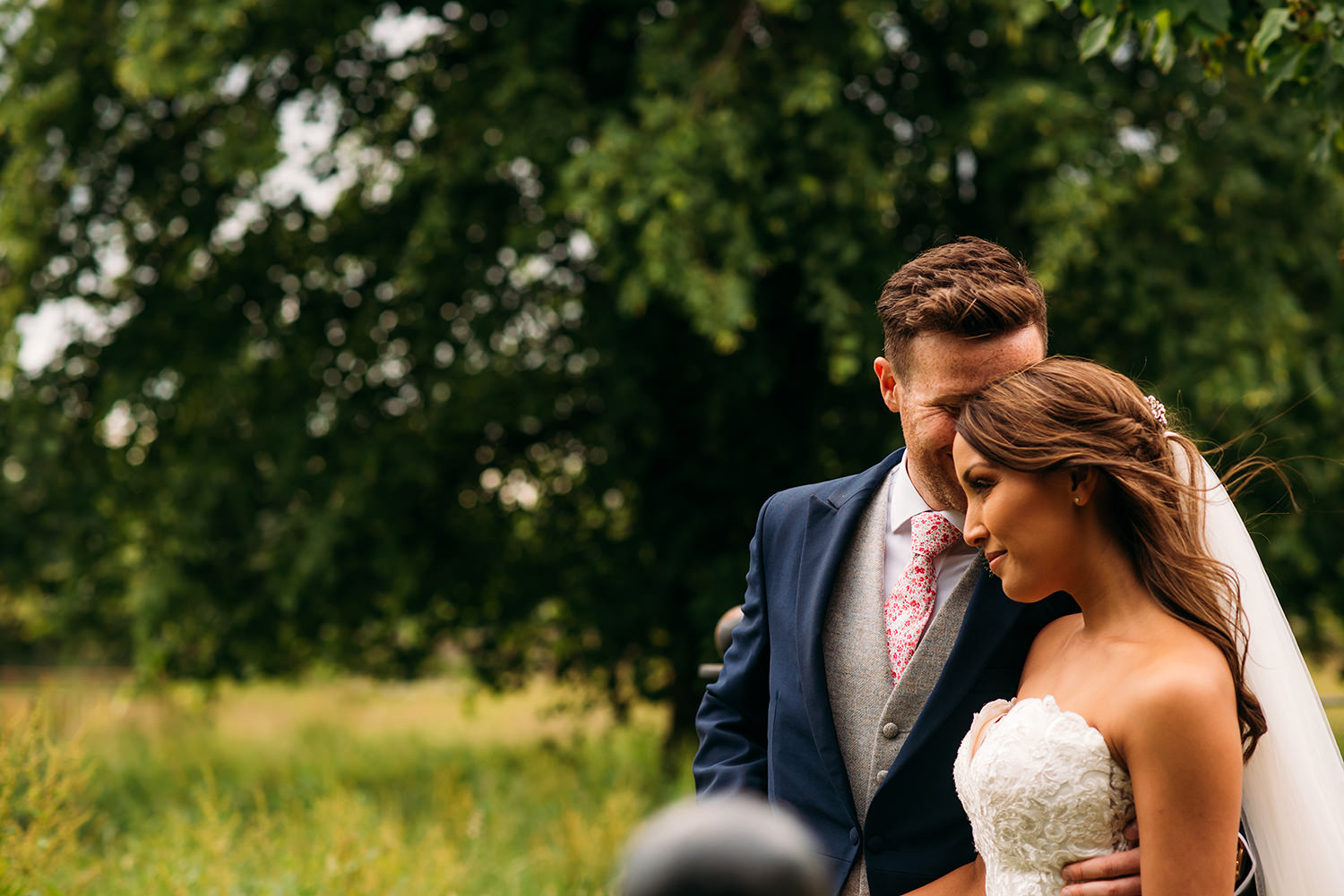 colour photo, bride and groom in field