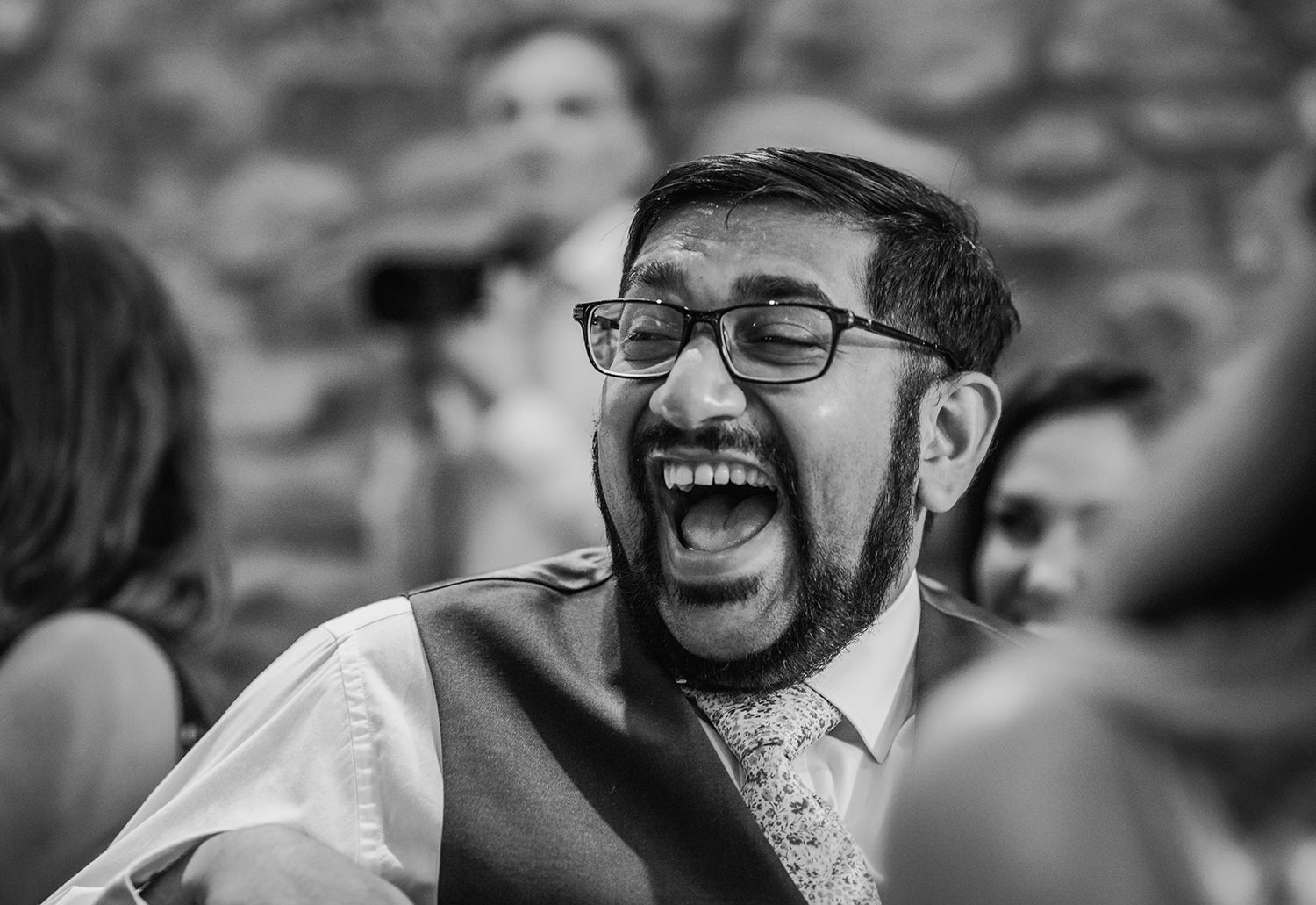 black and white photo of friend laughing