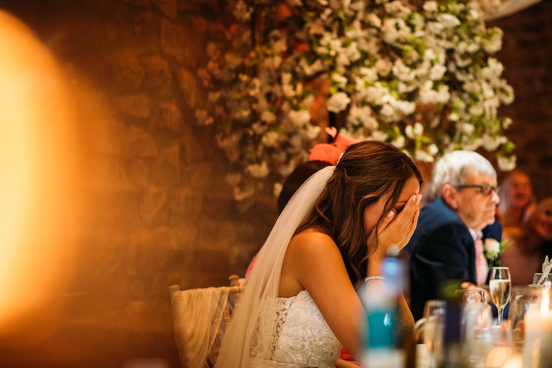 colour photo, bride head in hands
