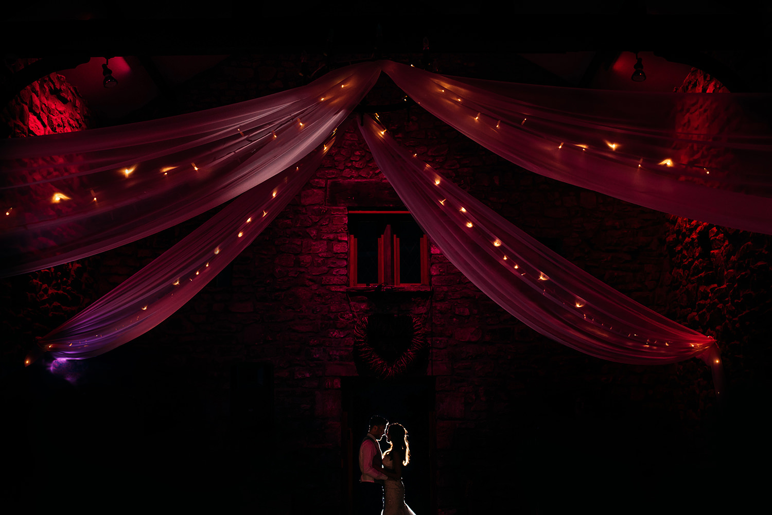 colour photo of bride and groom at night