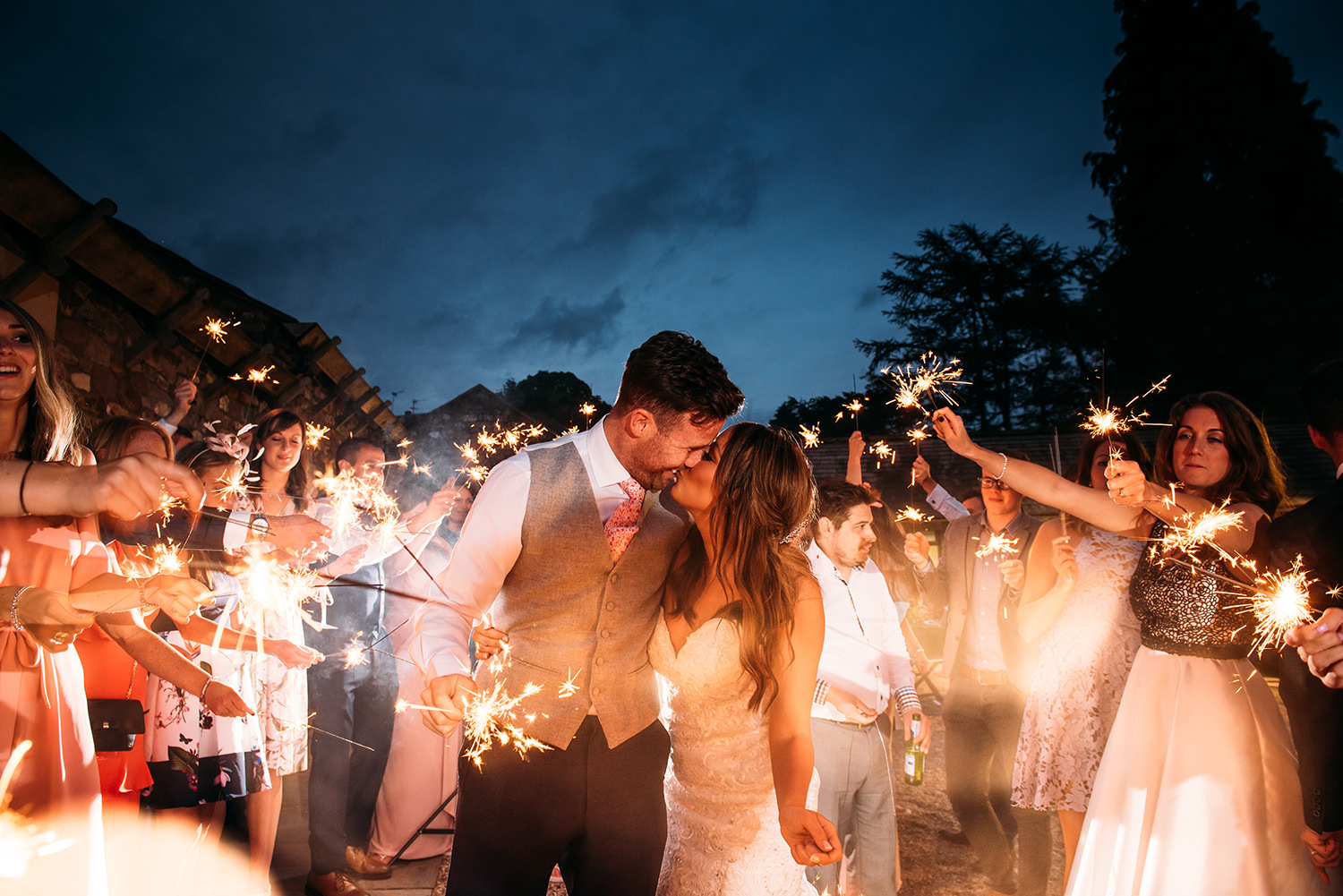 couple and friends with sparklers