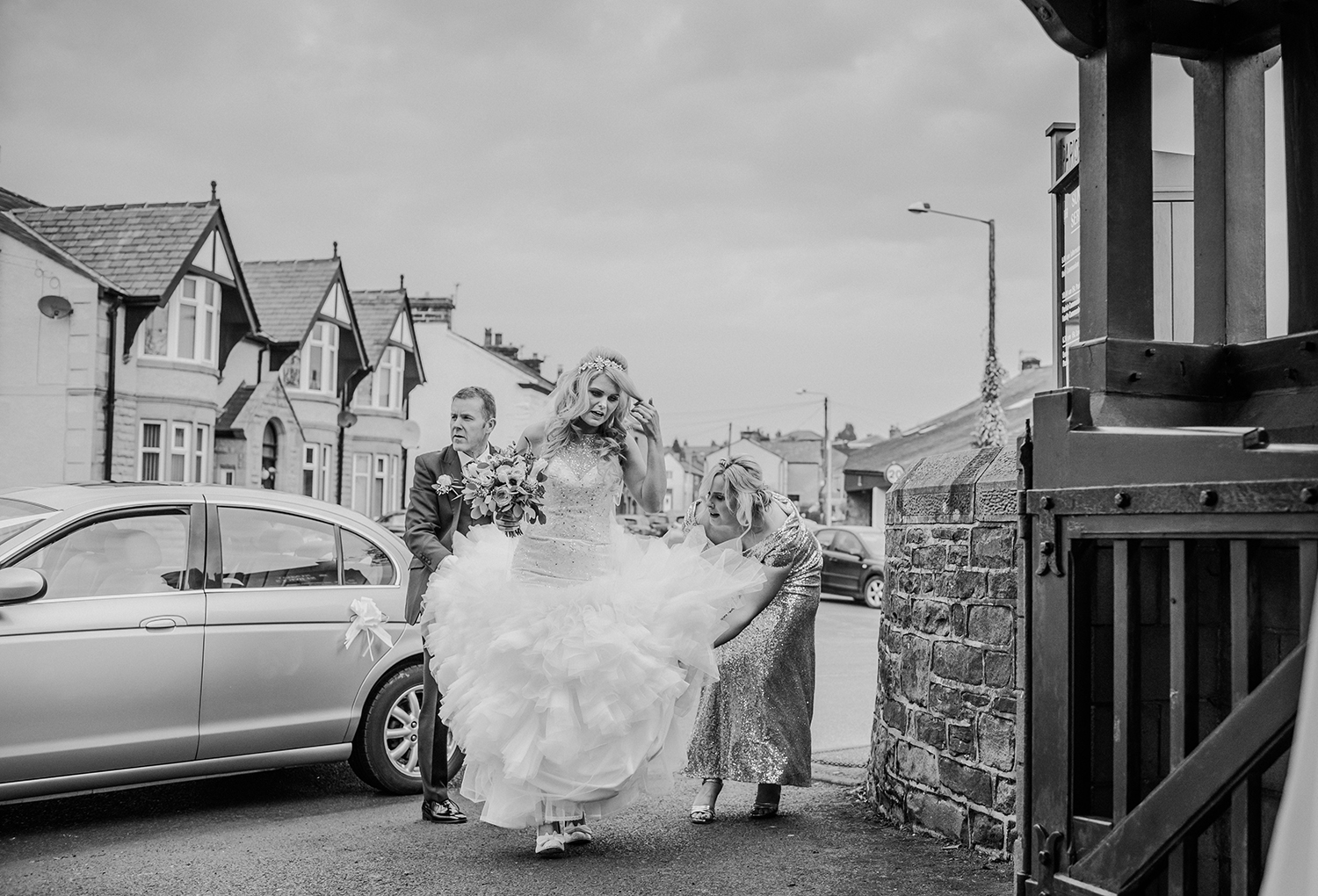 Bride and bridesmaids walking up church path