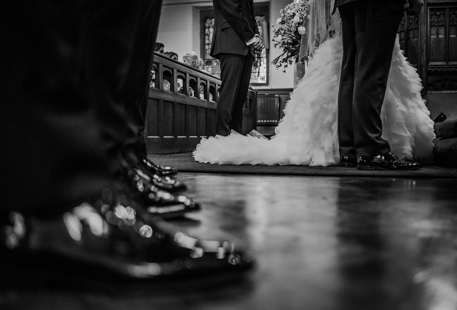 wedding dress and groomsmen shoes