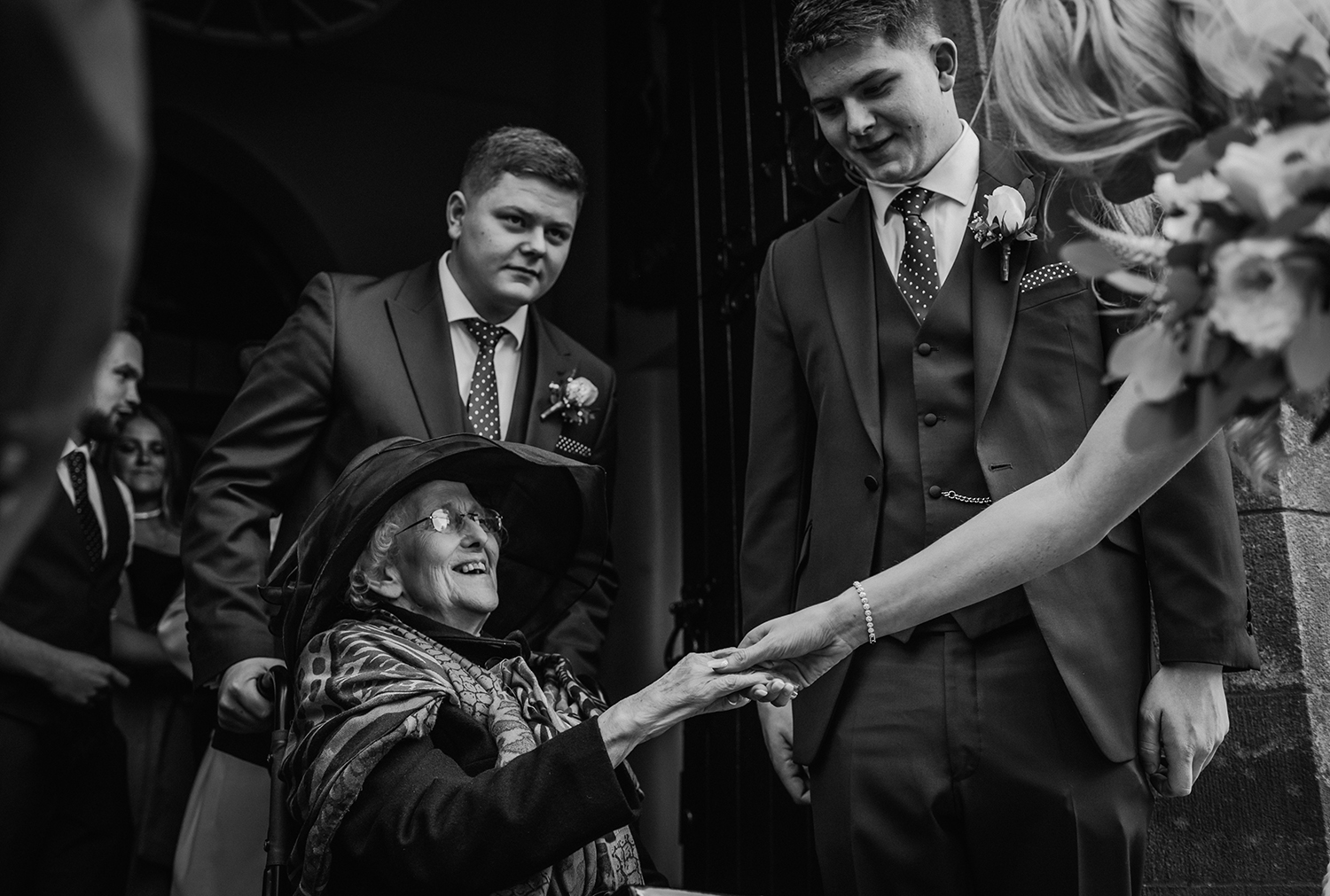 bride holds grandparents hand