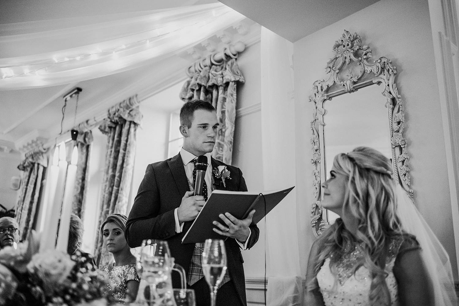 groom speaks to his wife