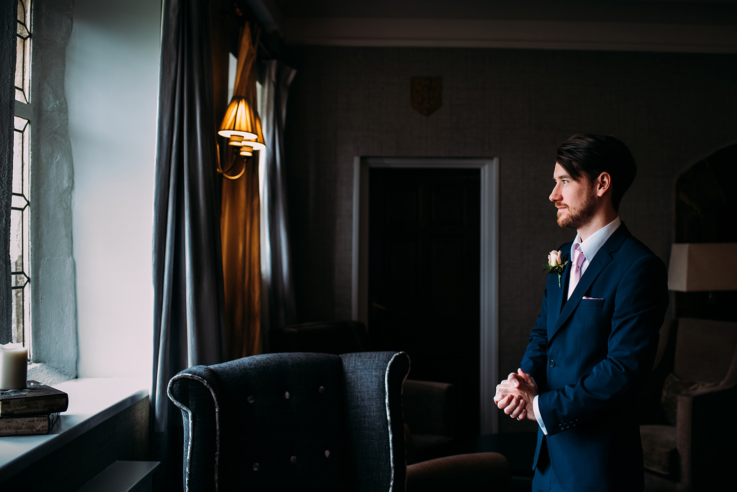 Groom looking out of the window