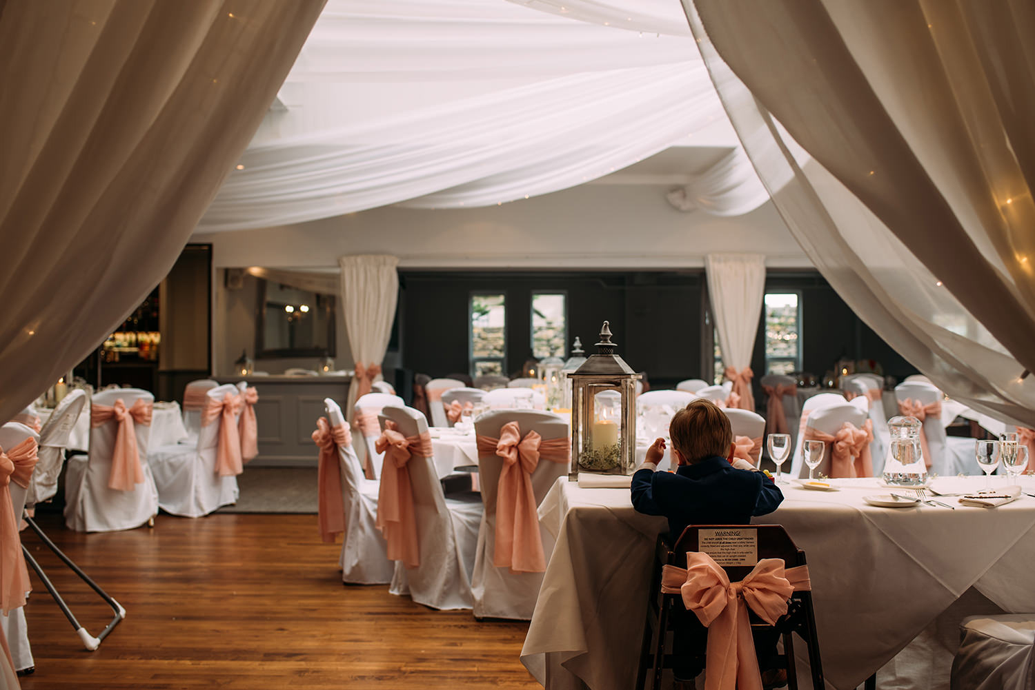 wedding breakfast room with little boy sat in his chair