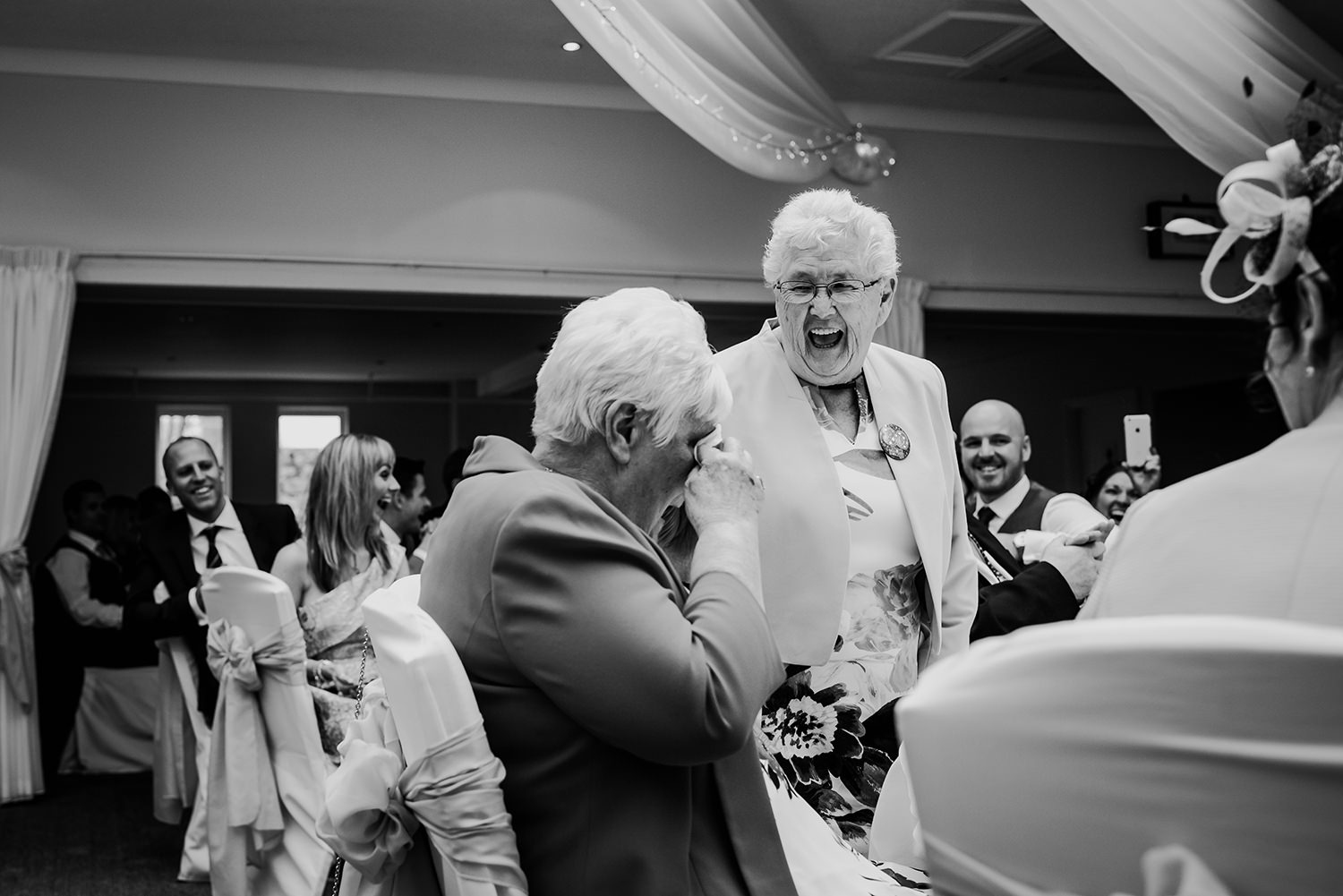 grandma standing up laughing during the wedding breakfast