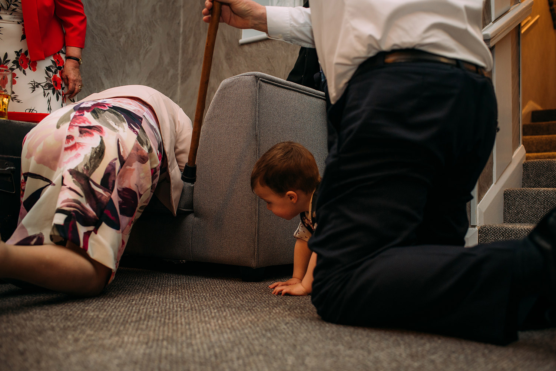 boy crawling after grandma