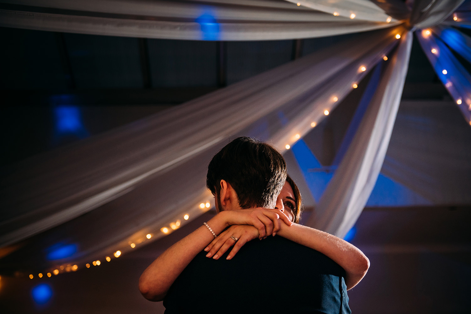 close up photo of couple embracing during first dance