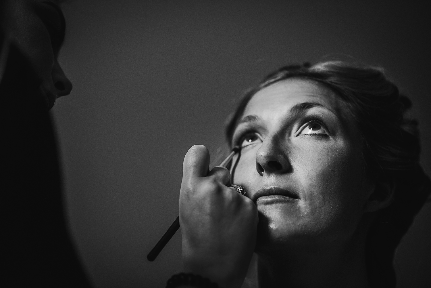 black and white image of bride having make up done