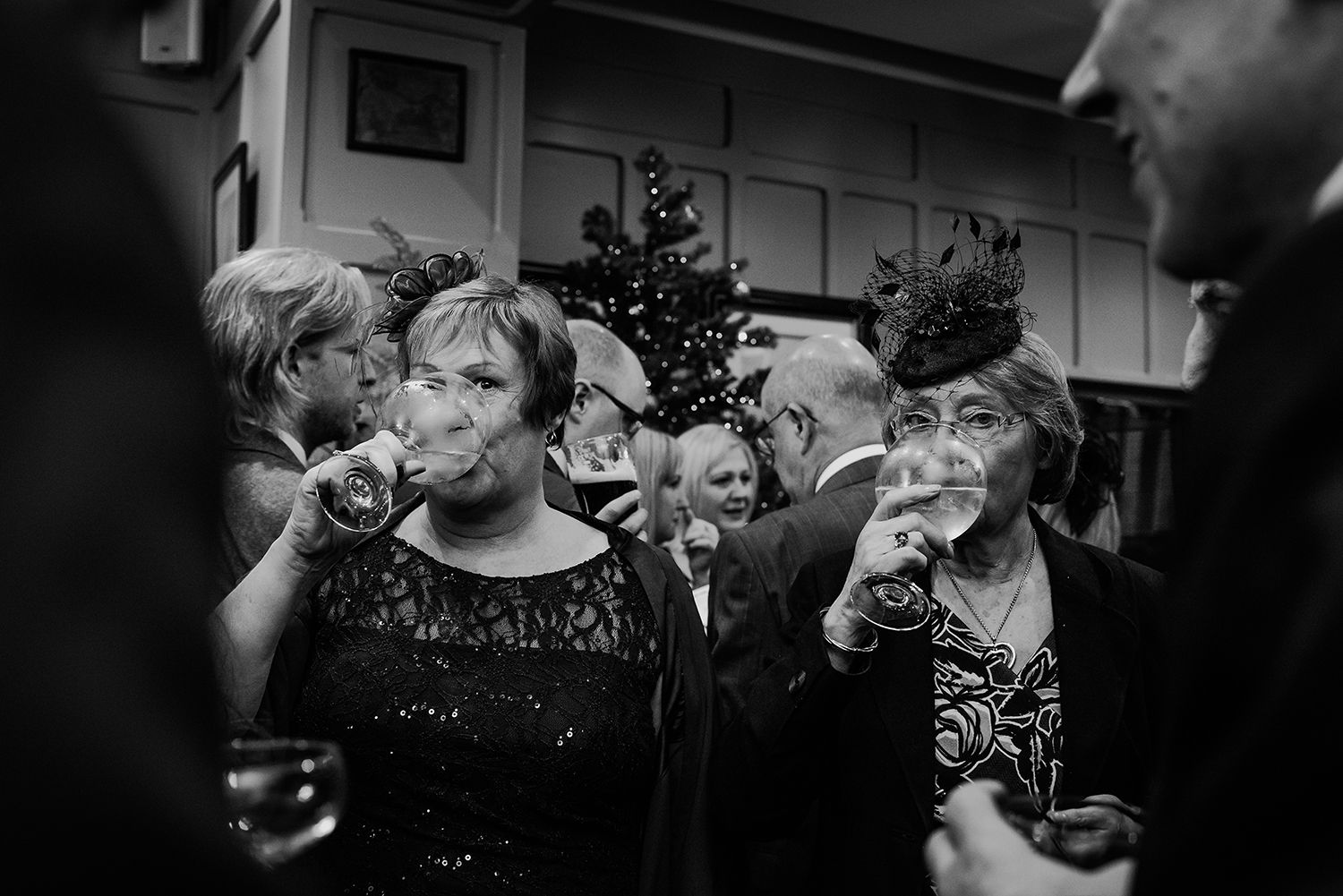 black and white photo of guests drinking