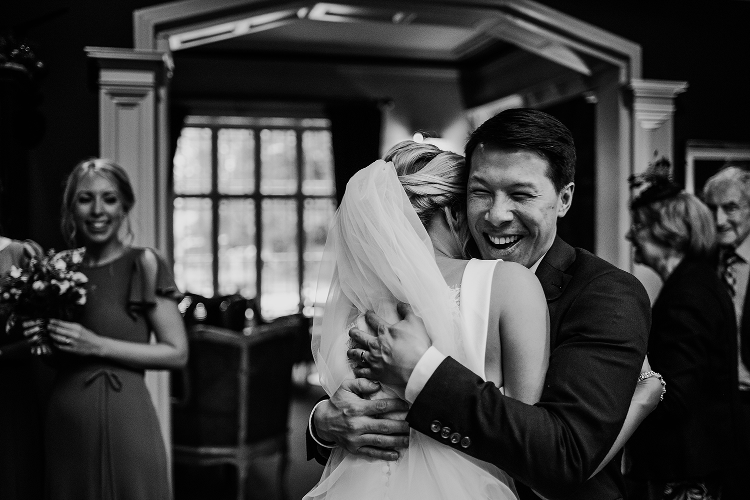 BW photo of guests hugging