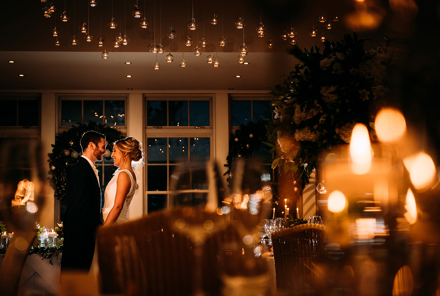 bride and groom in the candle lit reception room