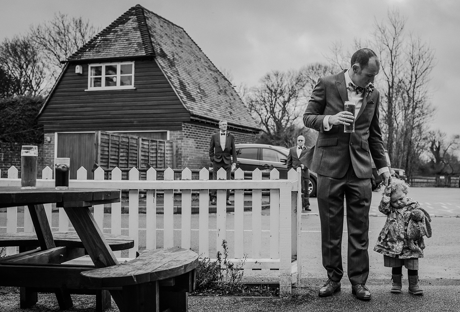 groom and daughter coming to the pub. BW photo
