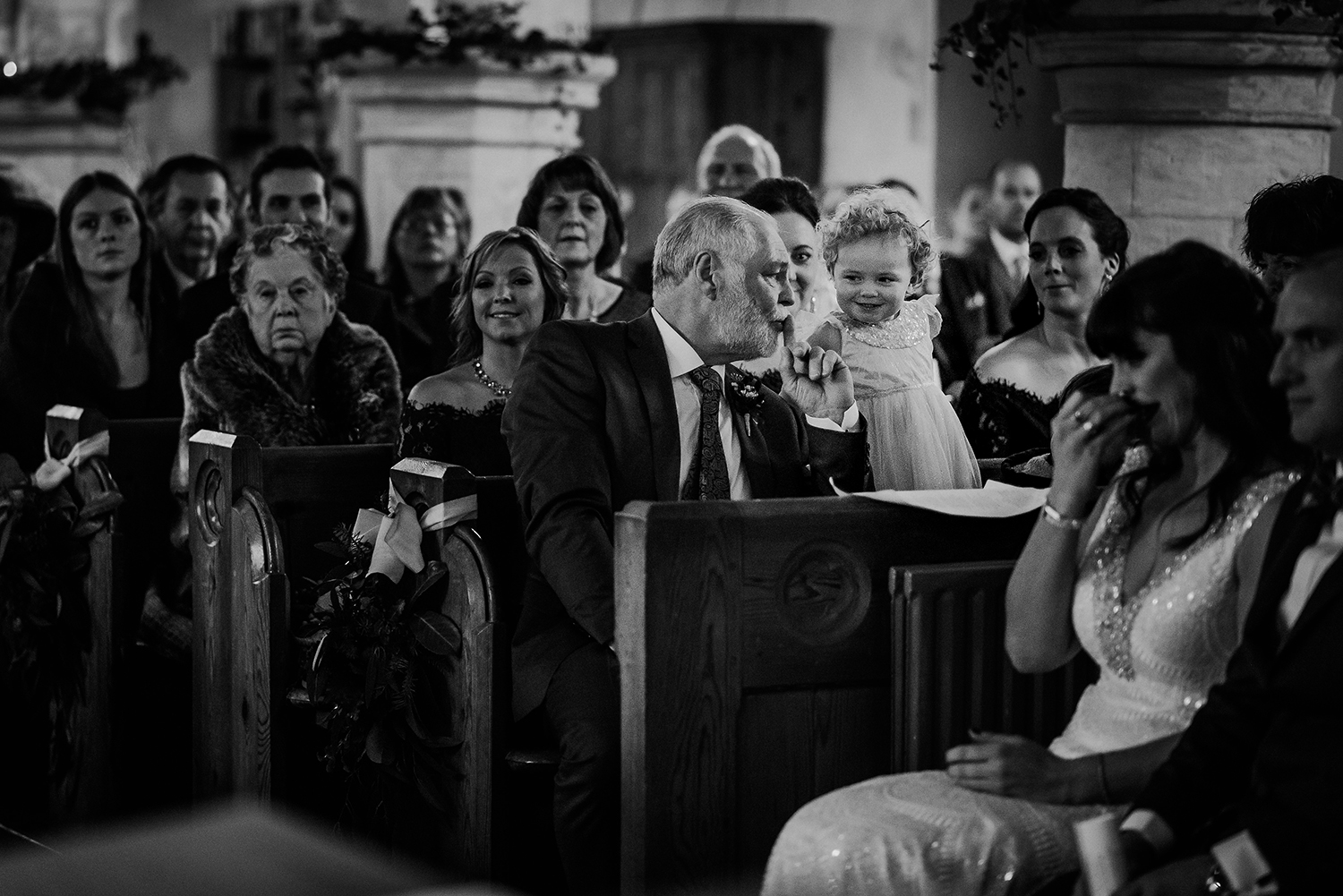 bride and grooms daughter getting told to be quiet by grandad. BW photo