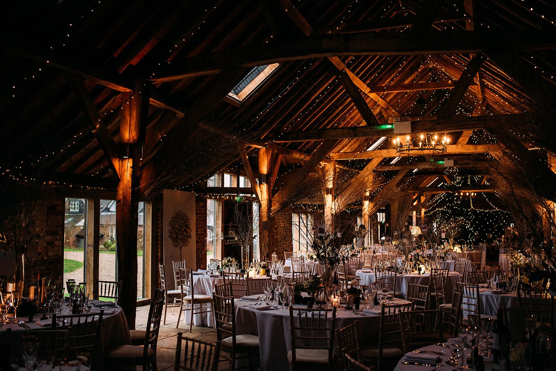 The long barn set for the wedding breakfast