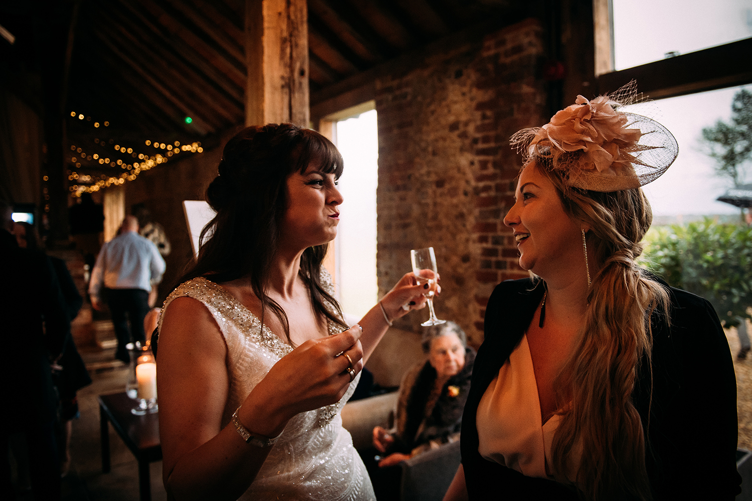 bride and friend laughing with food in mouth