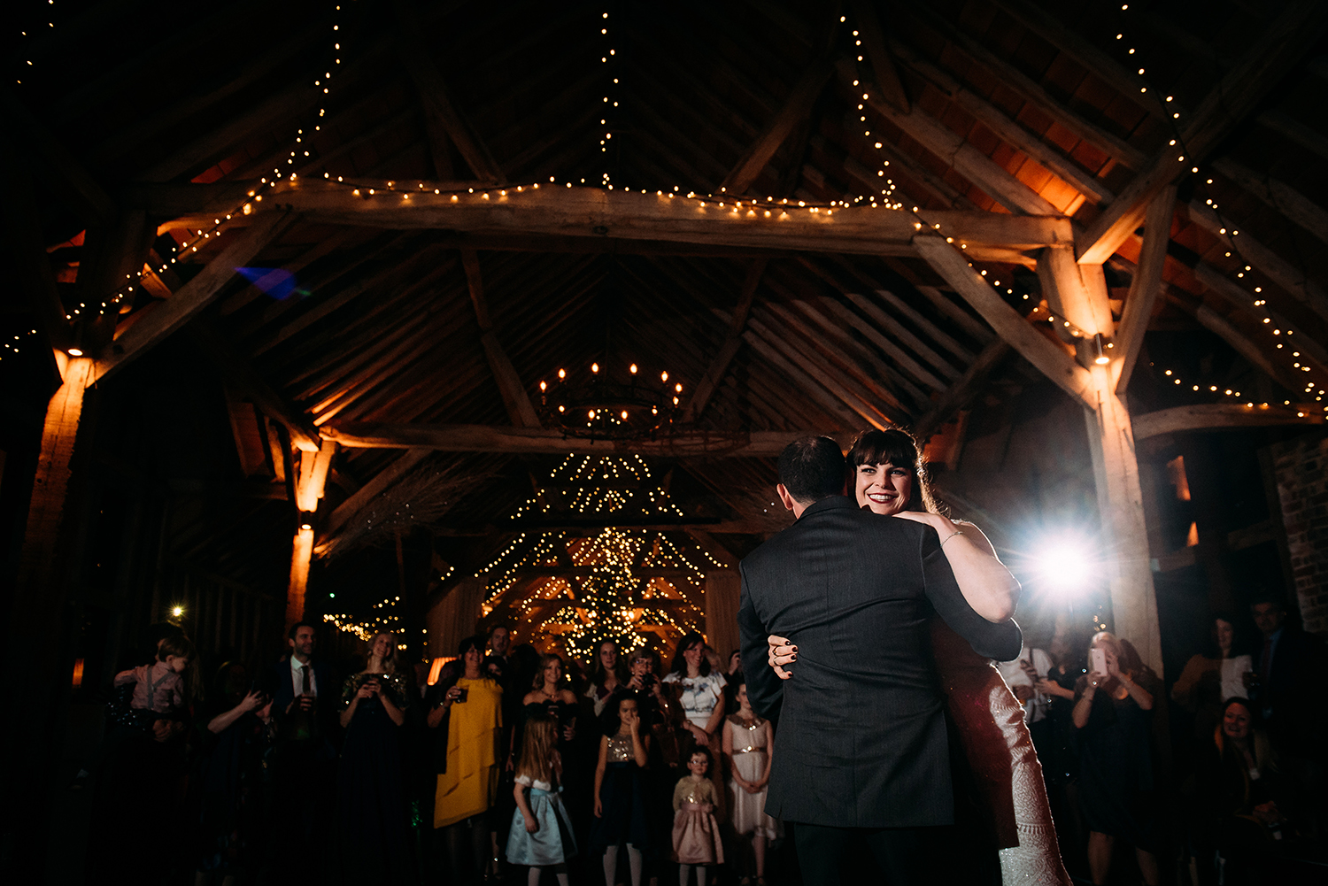 bride smiles during first dance