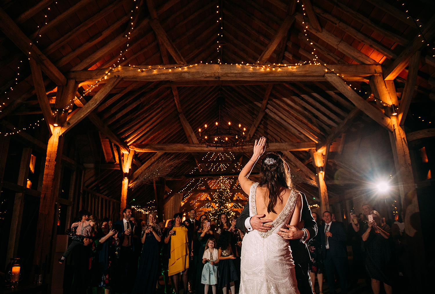 bride lifts arm during first dance