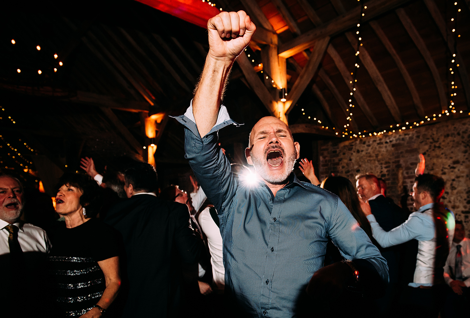 guest 'fist pumping' on the dancefloor