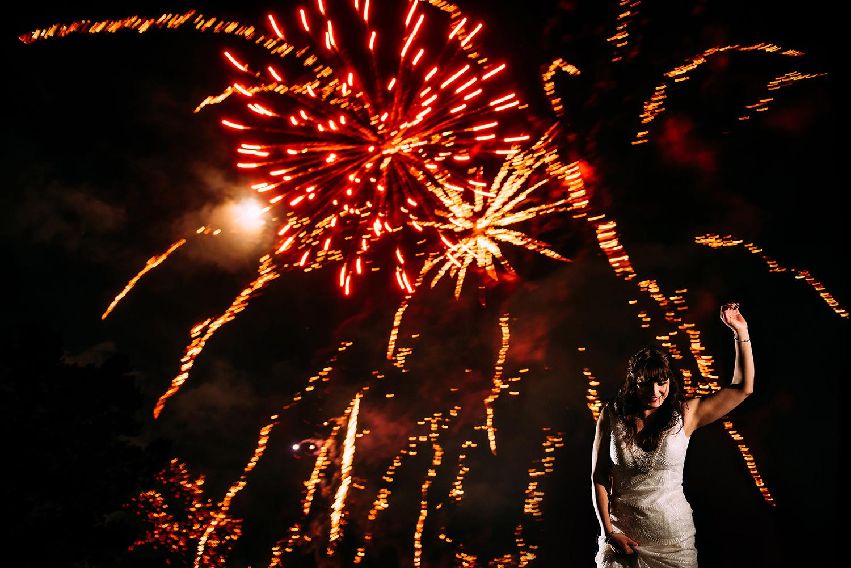 bride dancing under fireworks