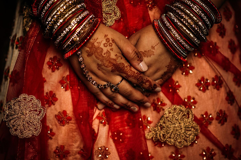 brides hands with henna tattoo's