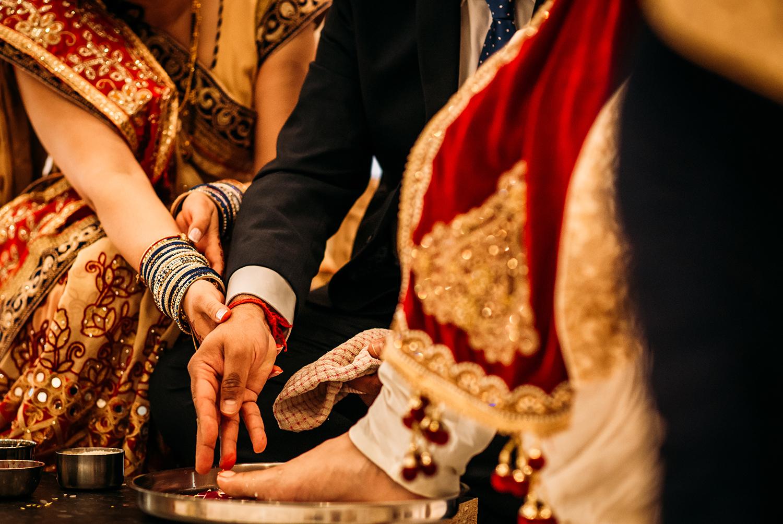 brides parents washing grooms feet