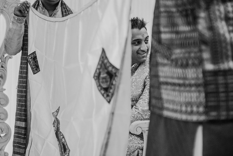 bw photo of groom