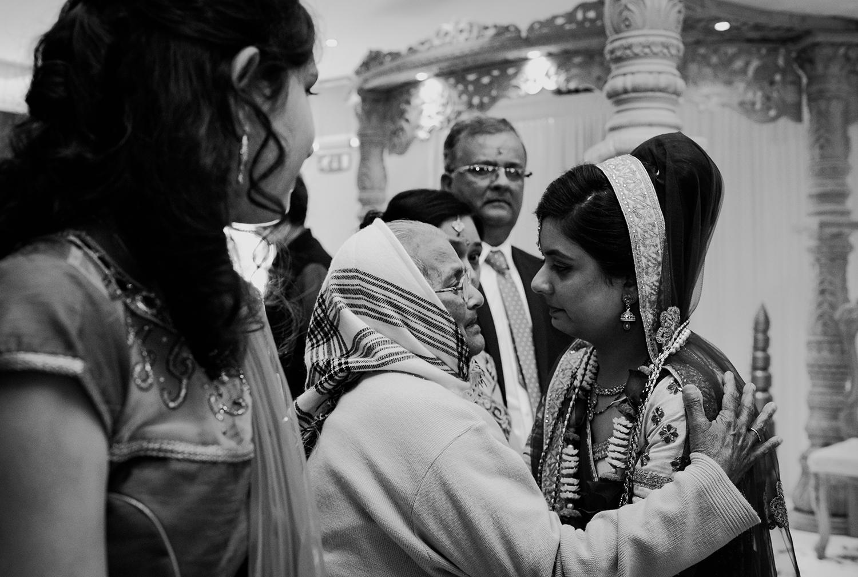 bw photo. Emotional shot of bride saying goodbye to her grandmother
