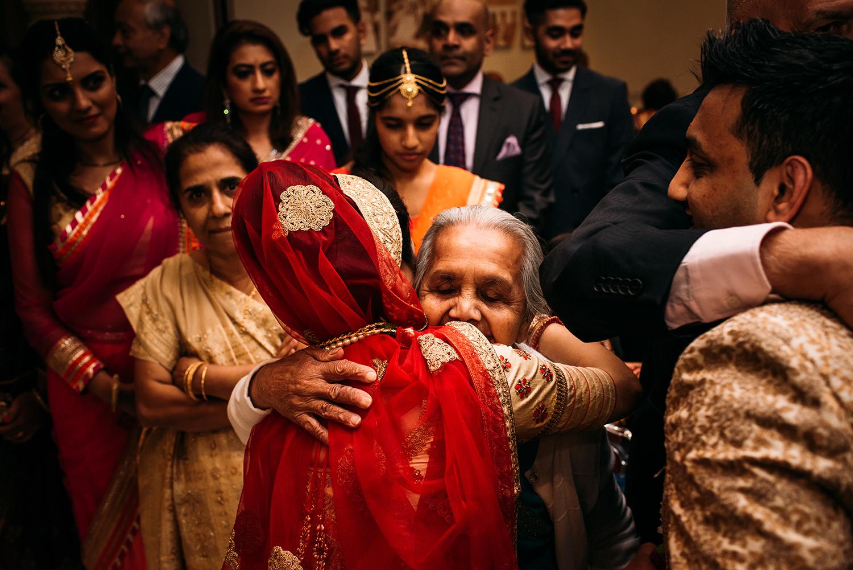 emotional image of bride hugging a relative