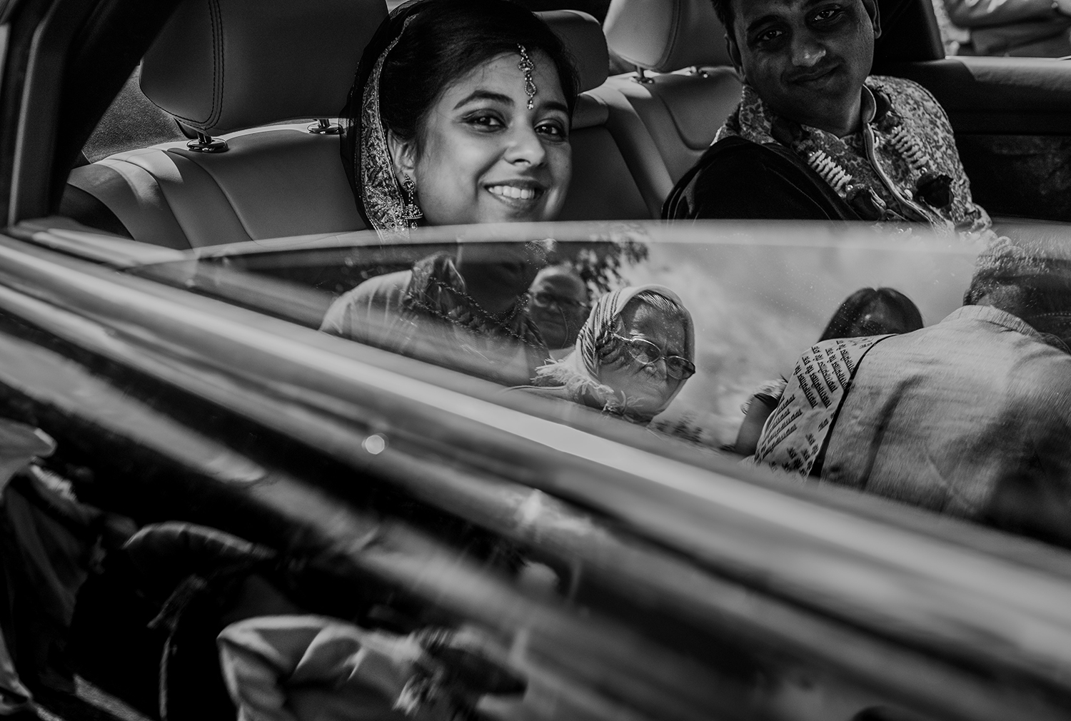 bw photo. Brides grandmother reflecting in the car window
