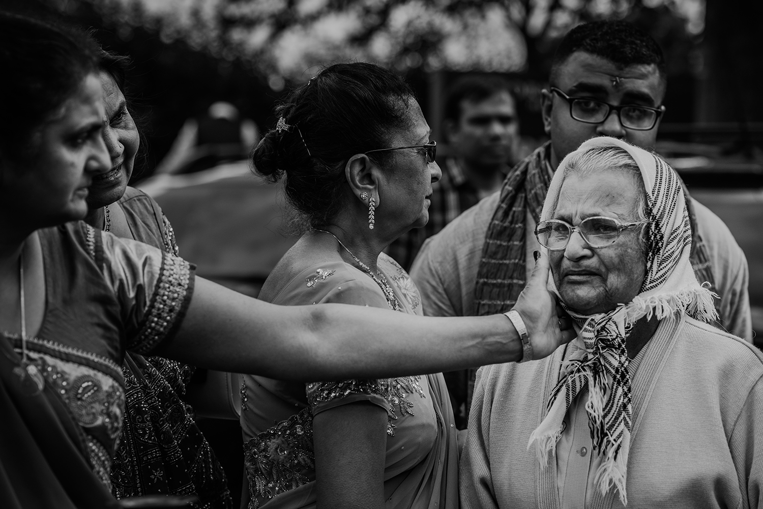 bw photo. Brides aunt tenderly comforting an emotional grandmother