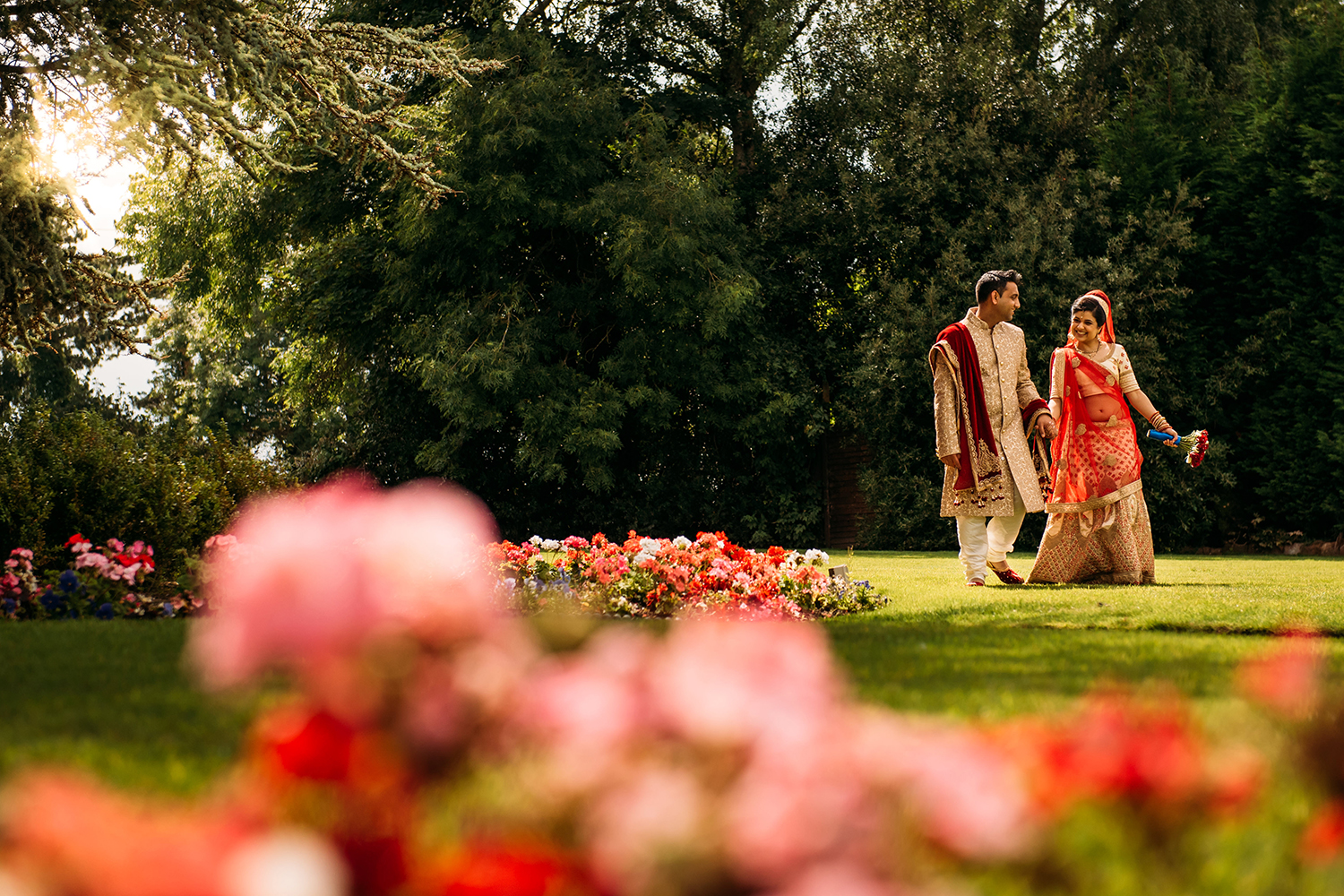 bride and groom strolling through the grounds