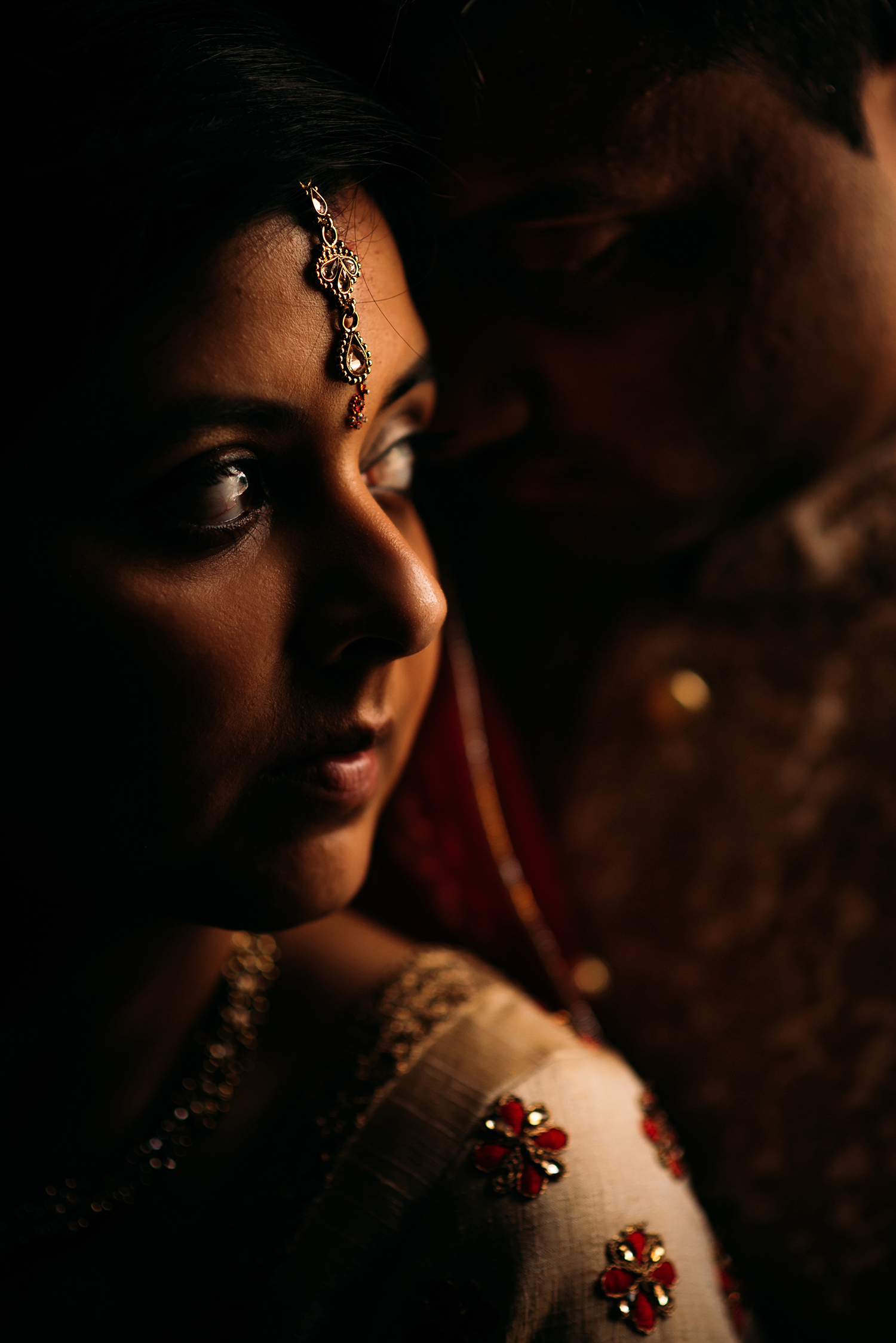 dark photo of bride and groom by brilliant window light