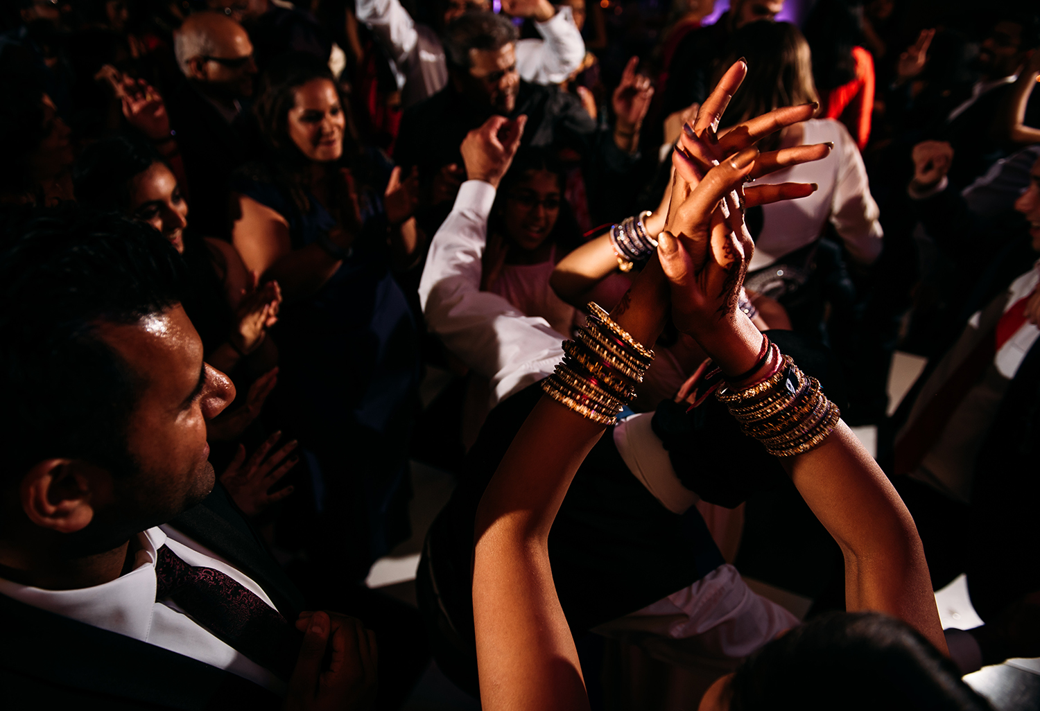 clasping hands on the dance floor