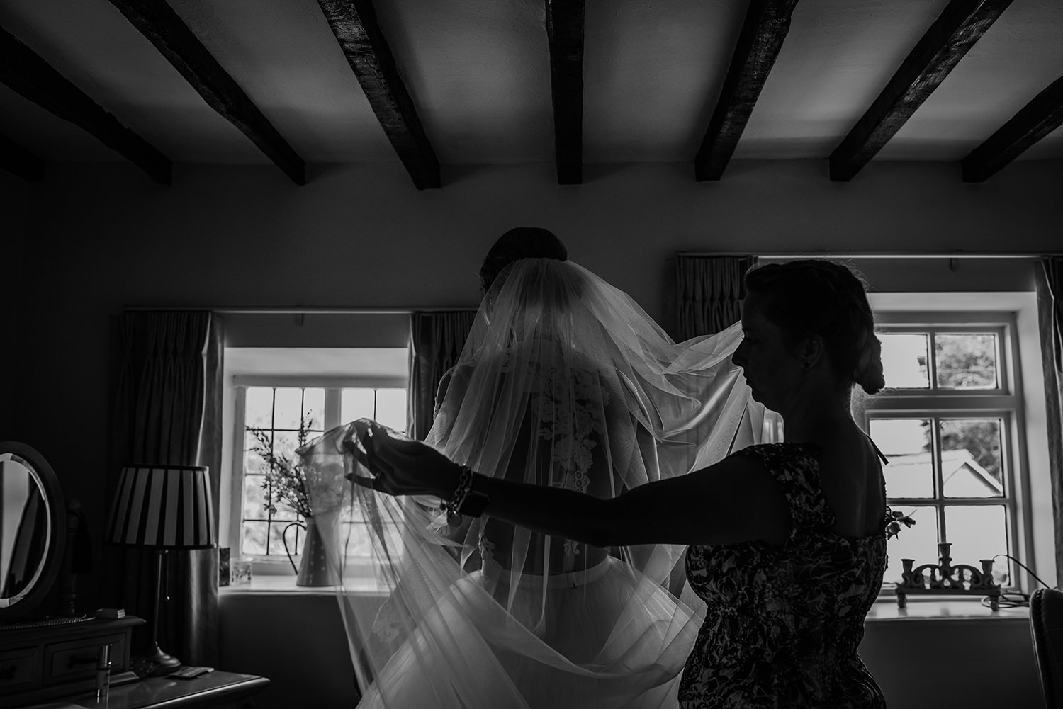bw photo of the bride's veil being fitted