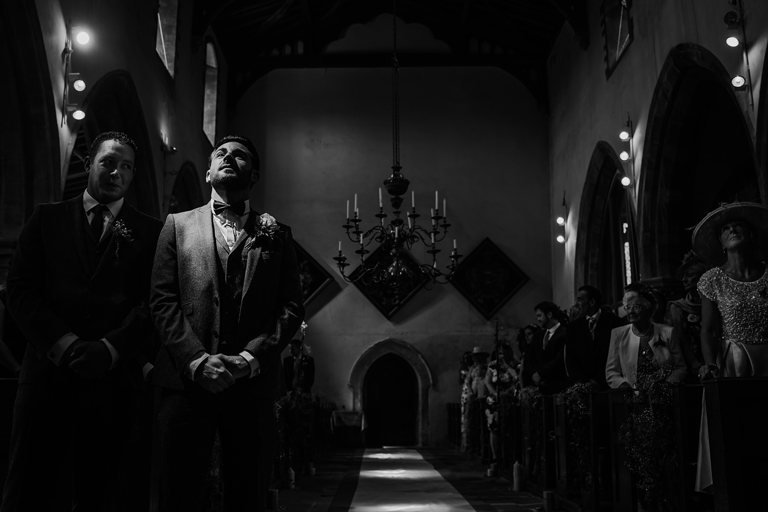 bw photo. Nervous groom takes a deep breath